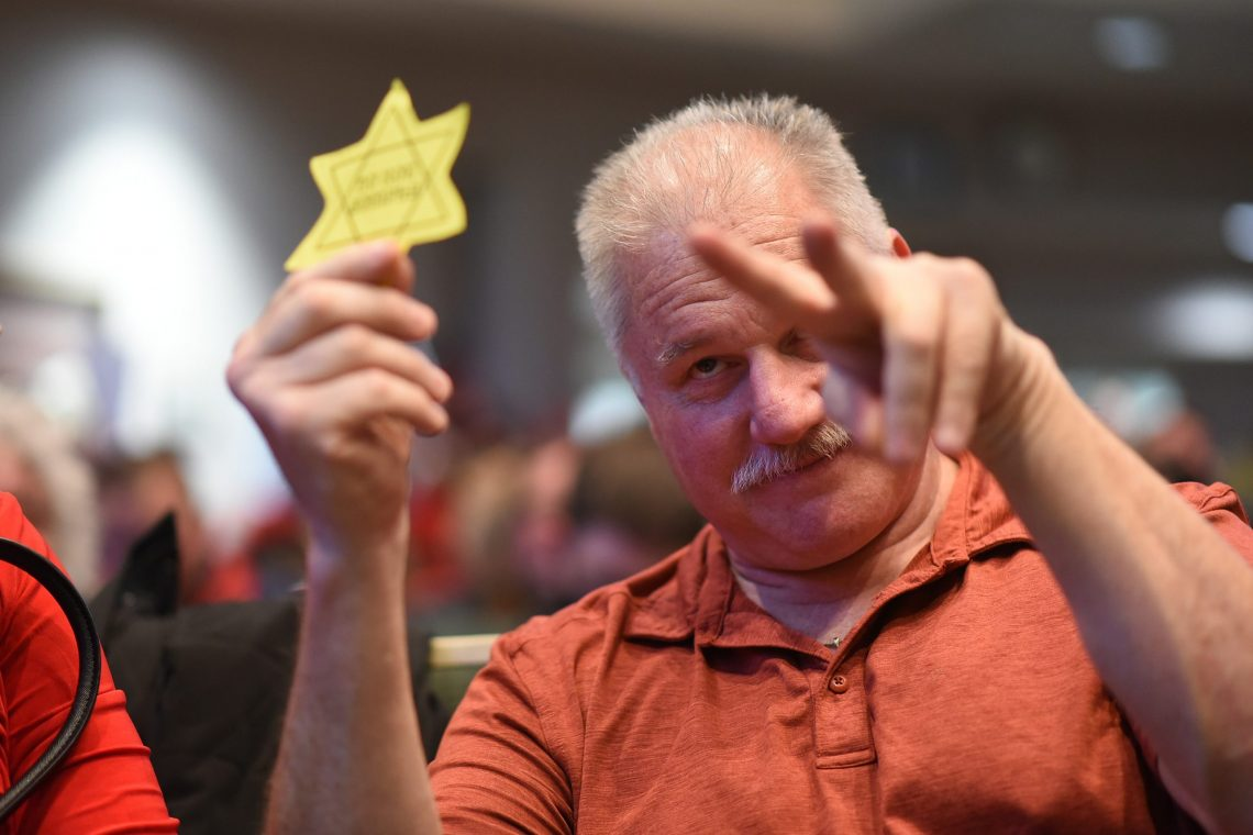 A man taunts Assembly Member Forrest Dunbar, who is Jewish, with a Star of David