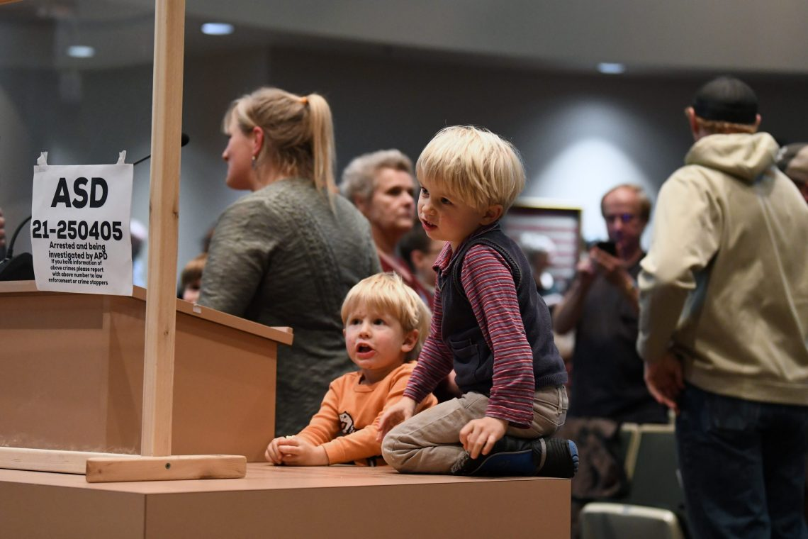Children climb on the podium during a break