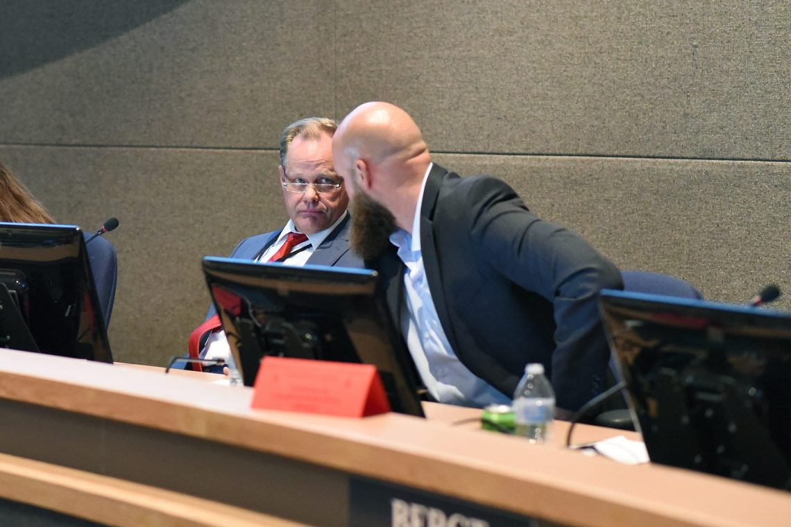 Mayor Dave Bronson consults with Adam Trombley